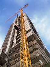 Bottom View Of An Under Construction Building With Blue Sky In Background