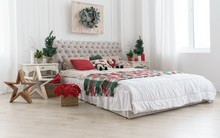 Decorated Bedroom For Christmas Holidays With Trees And Flowers In White Room