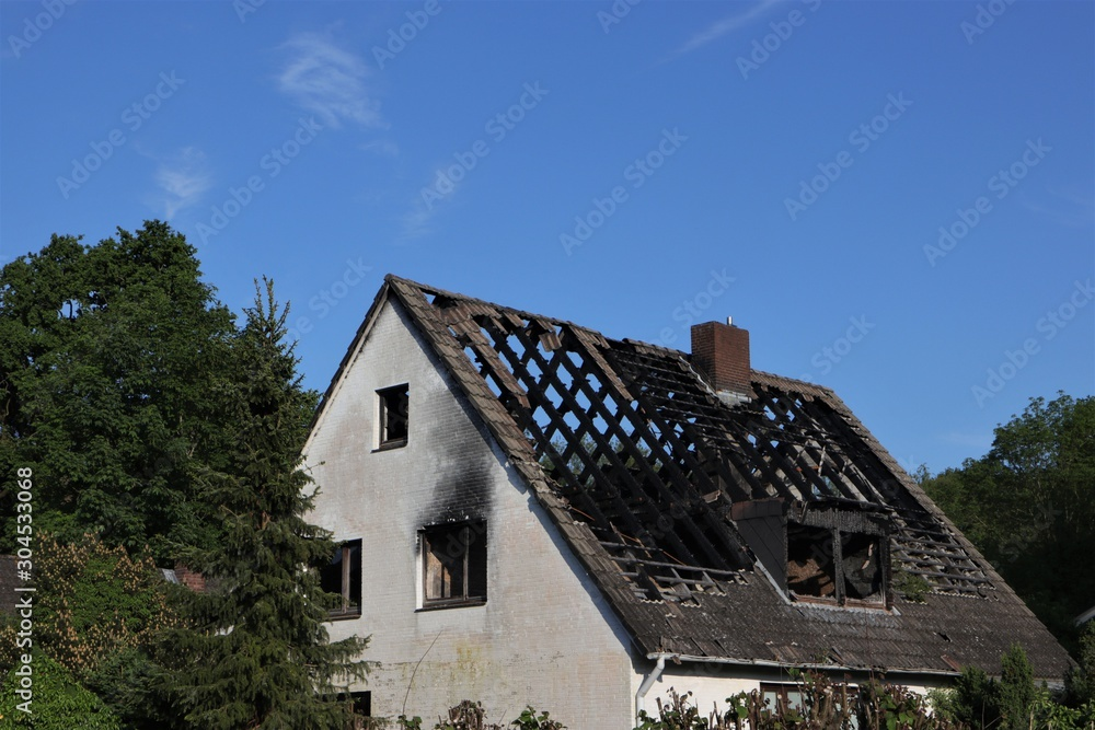 Fototapeta house fire,  burned roof truss, demolotion work, fire damage