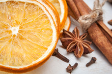 Dried Orange, Anise, Cinnamon, Cloves – Composition. On Wooden Background