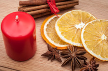 Christmas Composition – Candles, Dried Orange, Anise, Cinnamon. On Wooden Background