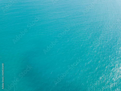 Tuinposter Luchtfoto Aerial view of turquoise waves, water surface texture. Thailand