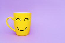 Smiley Yellow Coffee Cup On Pu...