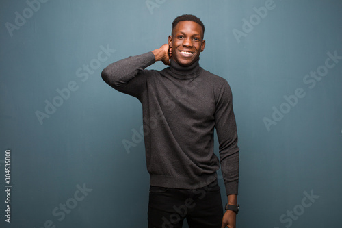 Obraz na plátně  young african american black man laughing cheerfully and confidently with a casu