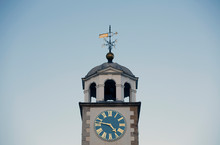 White Clock Tower Picture With Blue Sky