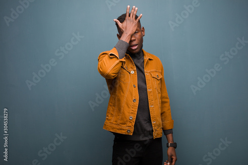 Fotografie, Obraz  young african american black man raising palm to forehead thinking oops, after m