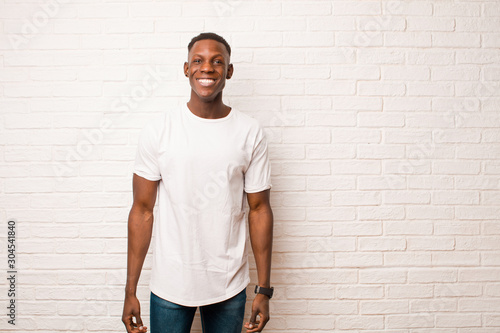 young african american black man looking happy and goofy with a broad, fun, loon Wallpaper Mural