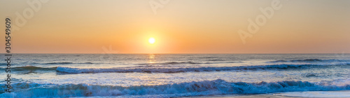 Fototapeta Dawn by the sea obraz