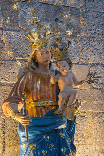 CATANIA, ITALY - APRIL 7, 2018: The carved polychrome statue of Madonna in Cattedrale di Sant'Agata.