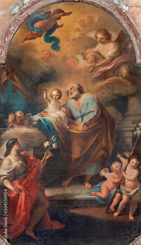 CATANIA, ITALY - APRIL 7, 2018: The painting of St. Joseph in Chiesa di San Nicolo by Mariano Rossi (1786).