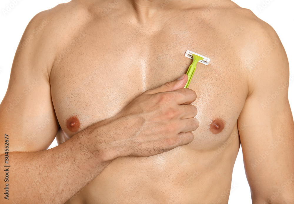 Fototapeta Handsome young man shaving torso on white background, closeup