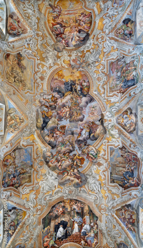 CATANIA, ITALY - APRIL 7, 2018: The vault fresco of Saint Benedict among the saints in church Chiesa di San Benedetto by Giovanni Tuccari (1667–1743).