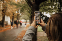 Young Woman Taking Photo With An Iphone