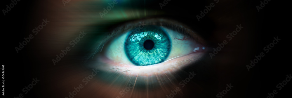 Fototapeta Future eye concept. Close up of a man's eye. Radial blur as a concept of movement. Banner with a dark background and an eye inside.