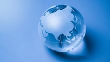 World Glass Globe On Blue Back...