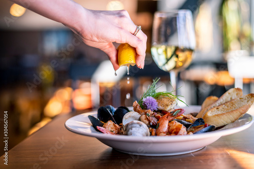 Fototapeta Bouillabaisse Seafood Soup Close-Up with Shrimp, Muscles, Clams, Fish, Fennel , Grilled Bread, and Wine obraz