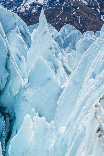 Fototapeta Danger of crevasses and seracs overhanging ice on the Matanuska Glacier, Alaska