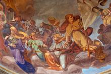 REGGIO EMILIA, ITALY - APRIL 12, 2018: The Fresco Of Angels With The Symbols In Cupola Of Church Basilica Di San Prospero By  C. Manicardi, G. Ferrari And A. Lugli (1884-1885).