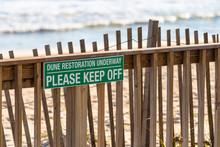 """Green Sign At Beach Reads: """"DU"""
