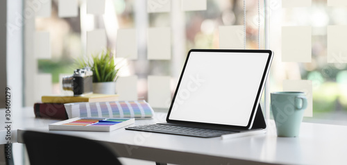 Obraz Cropped shot of modern designer workplace with blank screen tablet on white wooden table - fototapety do salonu