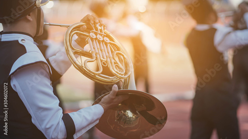 Fotografie, Obraz  Young student Musician playing the Frenchhorn with Music practice of Band, Music