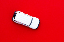 White Toy Car On Top View, Red Background