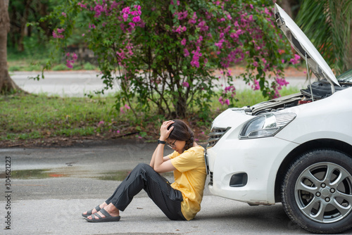 Young stressed woman having trouble with her car breakdown on the road and she waiting someone can help her Canvas Print