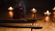 Burning Incense Stick. Buddha With Incense Sticks And Candle On Old Wooden Table.