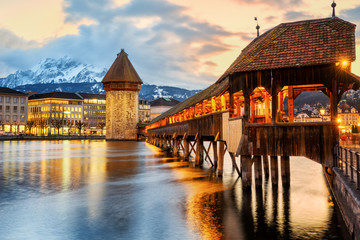 Lucerne city, historical Chapel bridge on sunset