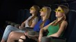 Young friends watching a film at the cinema 3d glasses