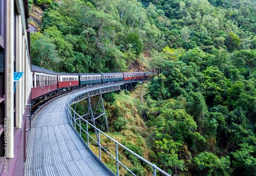 Fotomural Beautiful shot of Kuranda scenic railway surrounded by green tree forests in Aus