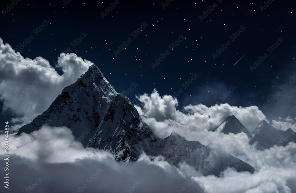 Fototapeta Top of mount in the clouds at night, Nepal