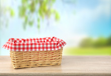 Straw Empty Basket Decorated With Picnic Checkered Cloth  Nature Background.