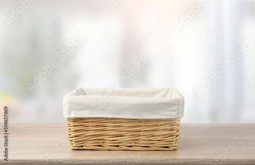 Obraz na plátně Straw empty basket with white linen on table.