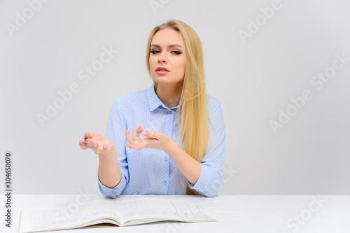 Obraz na plátně  Concept cute model student secretary works sitting at a table