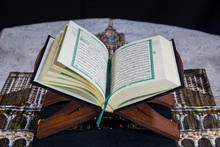 Muslims Islamic Holy Book Quran Majid With Quran Wooden Stand And Janamaz Prayer Rug And Black Background Surah Yaseen