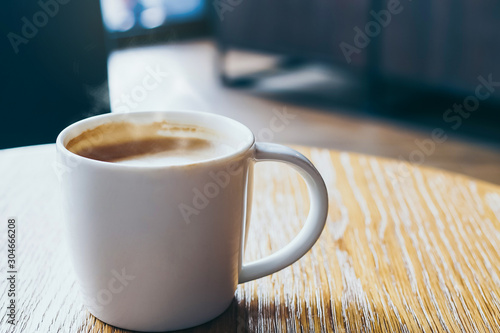 Wall Murals Cafe Hot coffee cup of latte art,coffee on wooden table in the morning.