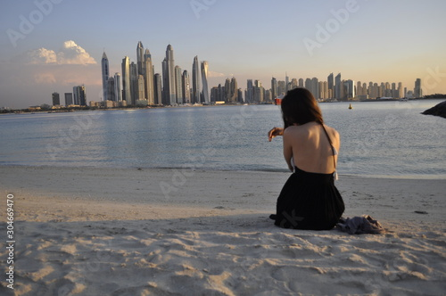 Spoed Fotobehang Dubai young woman on the beach