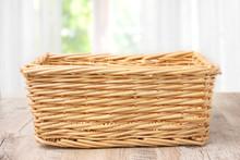 Wicker Basket On A Wooden Table