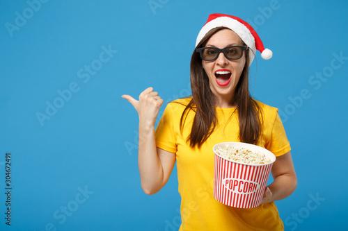 Santa girl in Christmas hat 3d imax glasses posing isolated on blue background Wallpaper Mural