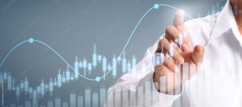 Fototapeta Businessman plan graph growth increase of chart positive indicators in his business