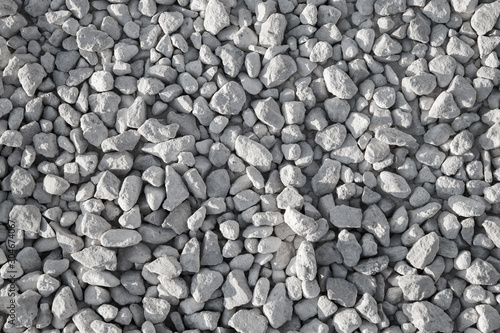 Photo Gray industrial gravel on the ground