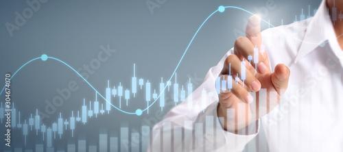 Businessman plan graph growth increase of chart positive indicators in his busin Wallpaper Mural