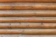 Wall Of A House Made Of Horizontal Natural Wooden Logs