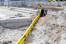 Underground Yellow Plastic Pipes In The Sand