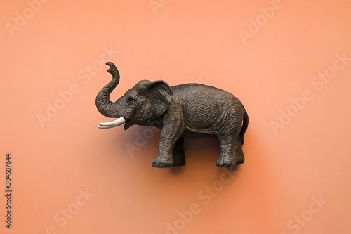 Toy elephant on orange background Wallpaper Mural