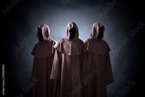Fotografia Group of three scary figures in hooded cloaks