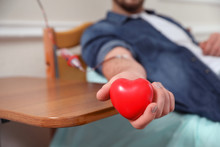 Man Donating Blood In Hospital...