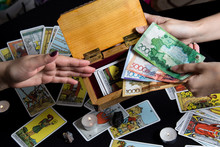 Bangkok,Thailand,november.22.19.Payment For Esoteric, Magical And Witchcraft Services In Kazakhstan In The National Currency Tenge. Payment With Tengu Money On A Black Background With Tarot Cards