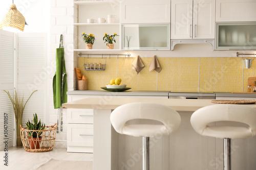 Modern kitchen interior with stylish white furniture Fotobehang